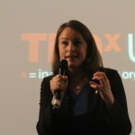 Sofie Sandell speaking at TEDxUCL on stage