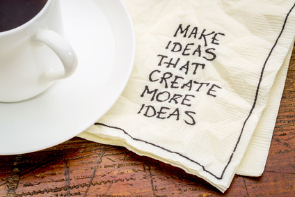 Make ideas advice that create new ideas - handwritten advice on a cocktail napkin with a cup of coffee